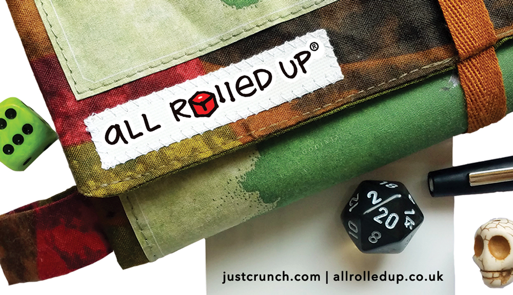 All Rolled Up game roll and dice bag corner showing label and dice